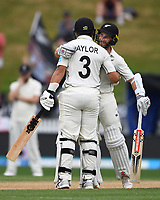 3rd December, Hamilton, New Zealand;  New Zealand captain Kane Williamson congratulates Ross Taylor on his century during play day 5 of the 2nd test cricket match between New Zealand and England at Seddon Park, Hamilton, New Zealand.