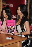 "LOS ANGELES, CA. - December 02: Kim Kardashian, Kourtney Kardashian attend the ""Kardashian Konfidential"" Book Signing at Borders Book store on December 2, 2010 in  Century City, California."