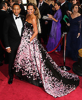 HOLLYWOOD, LOS ANGELES, CA, USA - MARCH 02: John Legend, Christine Teigen at the 86th Annual Academy Awards held at Dolby Theatre on March 2, 2014 in Hollywood, Los Angeles, California, United States. (Photo by Xavier Collin/Celebrity Monitor)