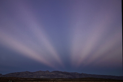 Clouds form lines at sunset at Death Valley National Park, California