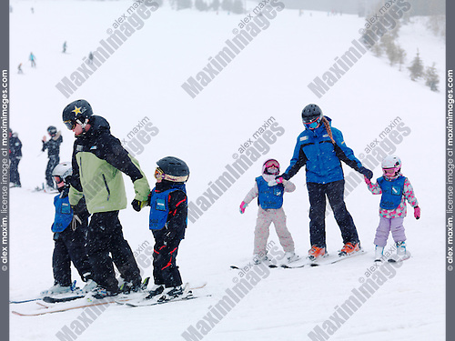Children learning skiing at Blue Mountain, Collingwood, Ontario, Canada alpine ski resort.