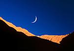 Crescent moon over Uluru-Kata Tjuta National Park, Northern Territory, Australia
