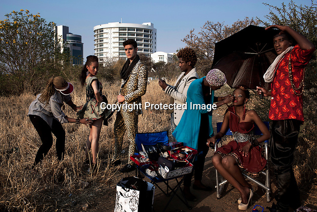 GABORONE, BOTSWANA AUGUST 28: Fashion designer Blacktrash on a location shoot with his models on August 28, 2012 in Gaborone, Botswana. He is one of Botswana's leading designers. Color in the Desert fashion week was held during the week with local and African designers invited. (Photo by: Per-Anders Pettersson)