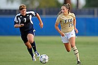 27 August 2011:  FIU's Marie Egan (13) moves the ball upfield with Akron's Ashley Hughes (7) in pursuit in the first half as the FIU Golden Panthers defeated the University of Arkon Zips, 1-0, at University Park Stadium in Miami, Florida.