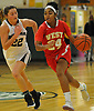 Kayla Robertson #24 of Half Hollow Hills West, right, gets pressured by Hallie Simkins #22 of Harborfields during the Russ Tietjen Invitational final at Harborfields High School on Friday, Dec. 1, 2017. Hills West won by a score of 61-54.