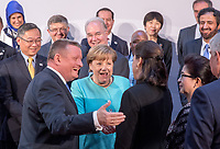 German Chancellor Angela Merkel (C), standing next to Federal Health Minister Hermann Grohe, greets the new French Health Minister Agnès Buzyn (R) during the Meeting of G20 Health Ministers in Berlin, Germany, 19 May 2017. Health Ministers from the G20 states and representatives of international organizations discussed global health topics during the two-day meeting. Photo: Michael Kappeler/dpa