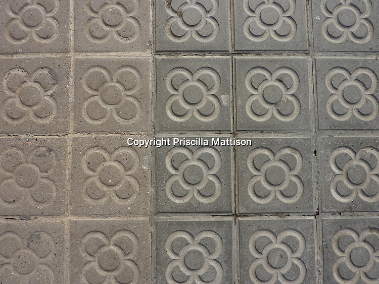 Barcelona, Spain - January 31, 2011:  Closeup of a distinctive pavement tile design in Barcelona, in use since the Nineteen Teens.