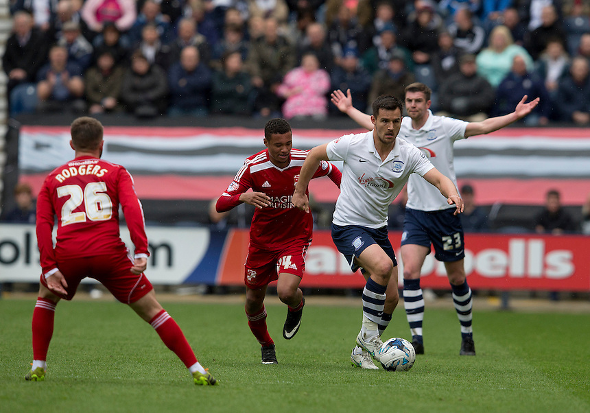 Preston North End's Bailey Wright gets away from Swindon Town's Jermaine Hylton<br /> <br /> Photographer Stephen White/CameraSport<br /> <br /> Football - The Football League Sky Bet League One - Preston North End v Swindon Town - Saturday 25th April 2015 - Deepdale - Preston<br /> <br /> &copy; CameraSport - 43 Linden Ave. Countesthorpe. Leicester. England. LE8 5PG - Tel: +44 (0) 116 277 4147 - admin@camerasport.com - www.camerasport.com