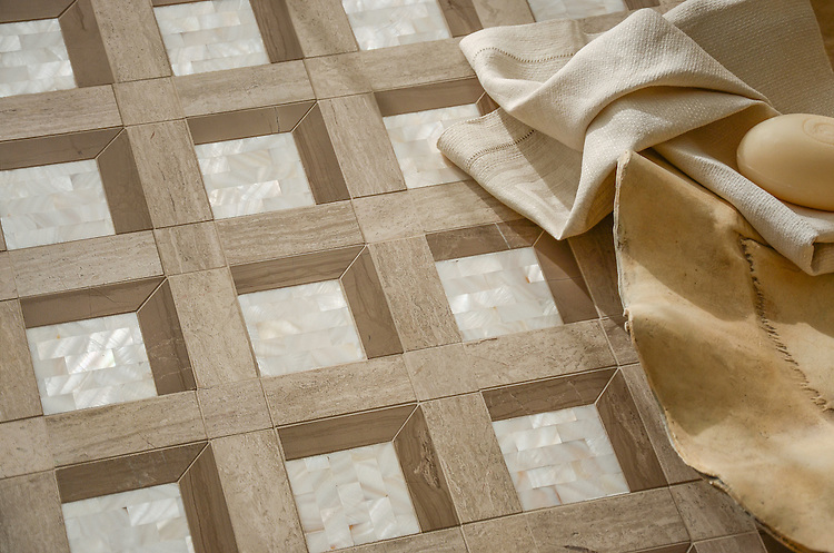 Paseo, a handmade mosaic shown in polished Driftwood, honed Whitewood, and Shell, was designed by Paul Schatz as part of the Illusions® collection by New Ravenna.