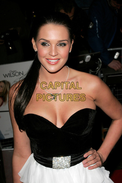 "DANIELLE LLOYD.""Marley & Me"" UK film premiere held at Vue cinema, Leicester Square, London, England..March 2nd, 2009. .half length black strapless bustier cleavage hand on hip ruffled  ponytail .CAP/AH.©Adam Houghton/Capital Pictures."