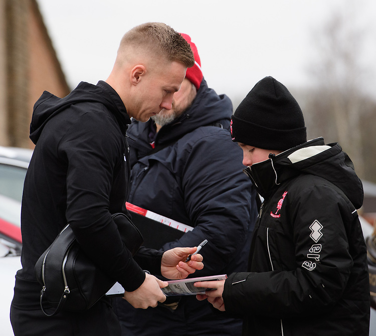 Lincoln City's Danny Rowe signs autographs for fans after arriving at the ground<br /> <br /> Photographer Chris Vaughan/CameraSport<br /> <br /> The EFL Sky Bet League Two - Lincoln City v Grimsby Town - Saturday 19 January 2019 - Sincil Bank - Lincoln<br /> <br /> World Copyright &copy; 2019 CameraSport. All rights reserved. 43 Linden Ave. Countesthorpe. Leicester. England. LE8 5PG - Tel: +44 (0) 116 277 4147 - admin@camerasport.com - www.camerasport.com