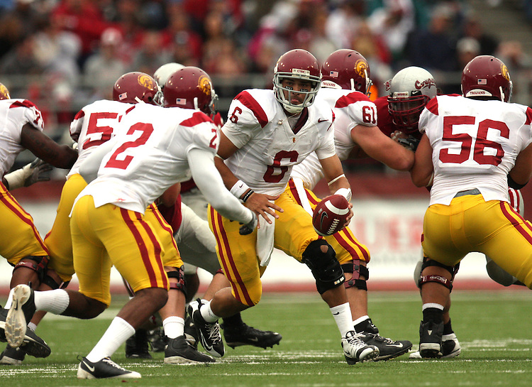 Mark Sanchez (#6), USC quarterback, prepares to hand off to running back C.J. Gable (#2) during the Trojans game with the Washington State Cougars on October 18, 2008, at Martin Stadium in Pullman, Washington.  Southern Cal won the game 69-0 to solidify their spot as one of the top ten college football teams in the country.