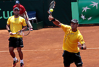 CALI - COLOMBIA - 05-04-2014: Juan Sebastian Cabal y Robert Farah de Colombia en accion contra Victor Estrella y Jose Hernandez de Republica Dominicana durante el dia dos de partidos en el Grupo I de la Zona Americana de la Copa Davis, partidos entre Colombia y República Dominicana en Estadio de Tenis Alvaro Carlos Jordan en la ciudad de Cali. / Juan Sebastian Cabal and Robert Farah of Colombia in action against Victor Estrella and Jose Hernandez of the Dominican Republic during day two in matches for the Group I of the American Zone Davis Cup, between Colombia and the Dominican Republic, at the Carlos Alvaro Jordan, Tennis  Stadium in the city of Cali. Photo: VizzorImage / Juan C Quintero / Str.