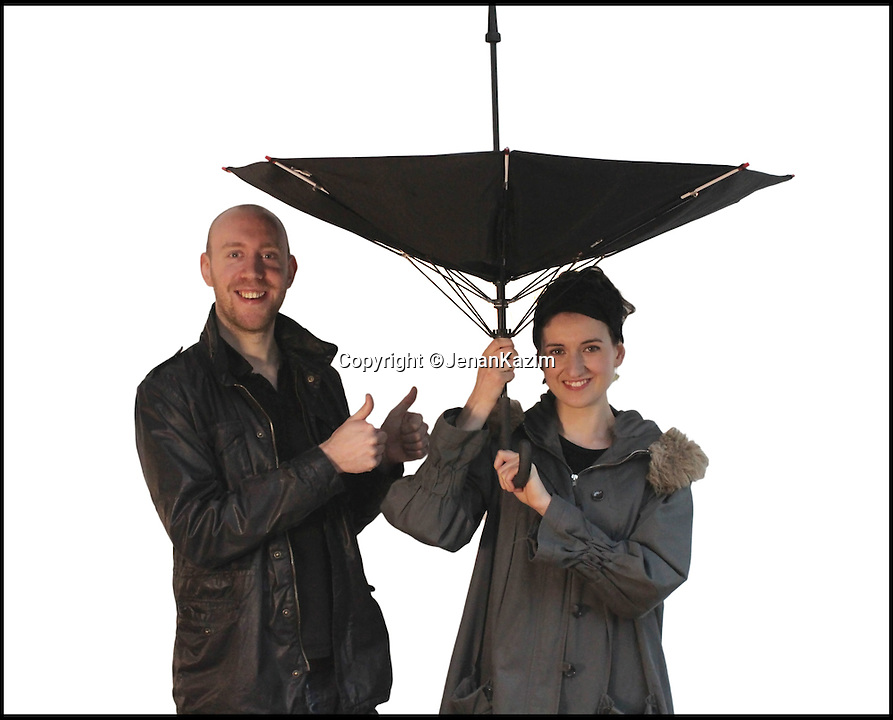 BNPS.co.uk (01202 558833)<br /> Pic: JenanKazim/BNPS<br /> <br /> ***Please Use Full Byline***<br /> <br /> The KAZbrella avoids poking peoples eyes. <br /> <br /> <br /> Inventor Jenan Kazim is turning world of the humble brollie inside out - after designing one that folds inwards to stop water dripping onto the floor.<br /> <br /> Rather than creating pools of rainwater on the floor when it is put away like standard umbrellas, Jenan's clever idea folds the opposite way collecting drips inside it.<br /> <br /> And thanks to its canny design which opens from the top rather than the bottom it puts paid to the age-old problem of poking passers-by in the head with brolly spokes.<br /> <br /> It also means users can stay dry for longer by putting their umbrellas down once they are sat inside their cars rather than before. <br /> <br /> The umbrella, which has been named the KAZbrella, will cost around 45 pounds when it is launched just in time for Britain's notoriously wet winter.