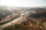 The IBC of PyeongChang Winter Olympics, Oct 30, 2017 : The International Broadcast Centre (IBC, top R) of the 2018 PyeongChang Winter Olympics and media village (L) are seen in PyeongChang, east of Seoul, South Korea. The 23rd Winter Olympics will be held for 17 days from February 9 - 25, 2018. The opening and closing ceremonies and most snow sports will take place in PyeongChang county. Jeongseon county will host Alpine speed events and ice sports will be held in the coast city of Gangneung. (Photo by Lee Jae-Won/AFLO) (SOUTH KOREA)