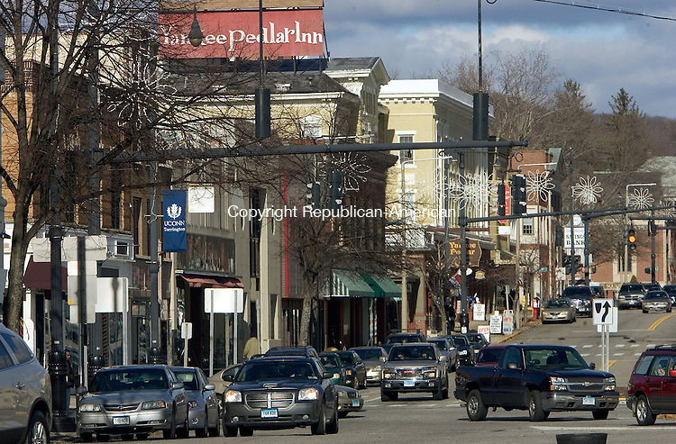TORRINGTON, CT. 24 November 2012-112412SV02-Cars pass through downtown in Torrington Saturday. The city wants to hire consultants who will oversee and coordinate the downtown. .Steven Valenti Republican-American