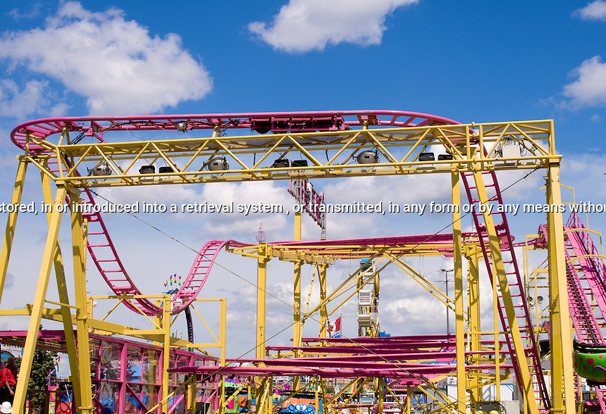 Purple Roller Coaster under Blue Sky