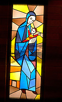 Stained glass window of Mary holding baby Jesus. Minneapolis Minnesota USA