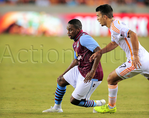 26.07.2014. Houston, Texas, USA.  Aston Villa midfielder Charles N'Zogbia(right) is challenged by Servando Carrasco during 1 - 0 win over the Houston Dynmao  at BBVA Compass Stadium in Houston, TX.