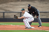 Coastal Carolina Chanticleers first baseman Tyler Chadwick (8) holds a runner during the game against the Bryant Bulldogs at Springs Brooks Stadium on March 13, 2015 in Charlotte, North Carolina.  The Chanticleers defeated the Bulldogs 7-2.  (Brian Westerholt/Four Seam Images)