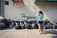 """Graffiti enthusiasts flock to the Williamsburg neighborhood of  New York on Friday, October 4, 2013 to see the one of the fourth installments of Banksy's graffiti art. Bansky annotated existing graffiti with the phrase """"The Musical"""" in three locations, in the Lower East Side, Bushwick and Williamsburg. The elusive street artist will be creating works around the city each day, during the month of October accompanied by a satirical recorded message parodying a museum tour which you can get by calling the number 1-800-656-4271 followed by  # and the number of artwork.  (© Richard B. Levine)"""