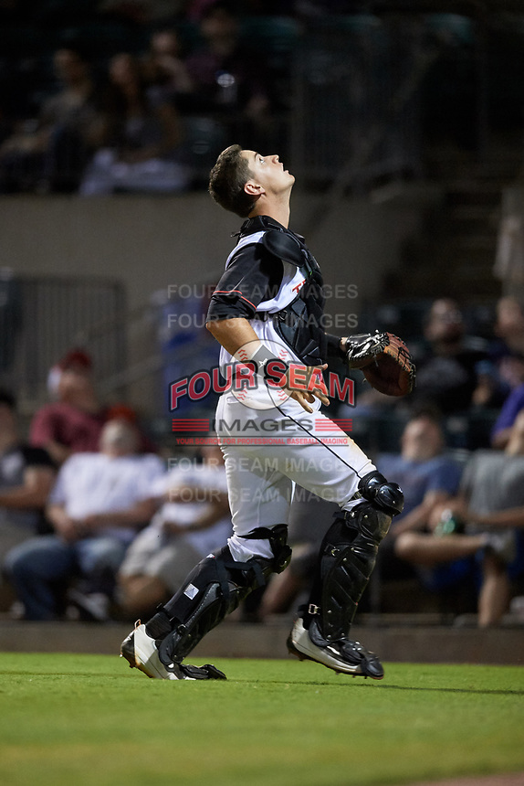 Arkansas Travelers catcher Marcus Littlewood tracks a pop up during a game against the Midland RockHounds on May 25, 2017 at Dickey-Stephens Park in Little Rock, Arkansas.  Midland defeated Arkansas 8-1.  (Mike Janes/Four Seam Images)