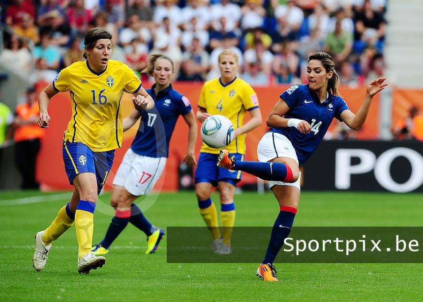Fifa Women's World Cup Germany 2011 : Zweden - France Frankrijk at Sinsheim World Cup stadium : Louisa Necib met de balcontrole voor Linda Forsberg.foto DAVID CATRY / Vrouwenteam.be
