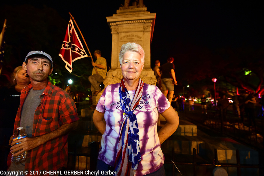 Protesters and counter-protesters clash over the removal of the Confederate Monuments at the Jefferson Davis monument, Monday night. Protesters clash at the Confederate Monument of Jefferson Davis