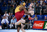 BROOKINGS, SD - NOVEMBER 4:  Henry Pohlmeyer from South Dakota State battles with John Meeks from Iowa State in their 141 pound match Friday evening at Frost Arena in Brookings. (Photo by Dave Eggen/Inertia)