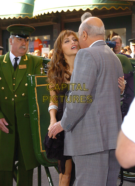 BRITTANY MURPHY & MOHAMED AL FAYED.Arrive to open the Harrods Summer Sale, .Knightsbridge, London, June 27th 2005..half length meeting greeting kissing.Ref: CAN.www.cap italpictures.com.sales@capitalpictures.com.©Can Nguyen/Capital Pictures