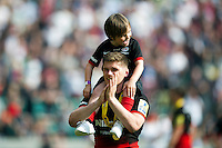 Owen Farrell of Saracens acknowledges the crowd after the match with his brother Gabriel on his shoulders. Aviva Premiership Final, between Saracens and Exeter Chiefs on May 28, 2016 at Twickenham Stadium in London, England. Photo by: Patrick Khachfe / JMP