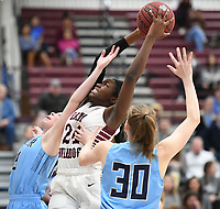 NWA Democrat-Gazette/J.T. WAMPLER Springdale's Marquesha Davis comes down with a rebound over Springdale Har-Ber's Kennedy Fotenopolus (LEFT) and Sophie Nelson Tuesday Jan. 9, 2018. Springdale beat Har-Ber 59-44. Davis scored 32 points in the game.