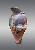 Minoan Kamares Ware beak spouted ewer jug with  polychrome decorations, Phaistos 1800-1600 BC; Heraklion Archaeological  Museum, grey background.<br /> <br /> This style of pottery is named afetr Kamares cave where this style of pottery was first found