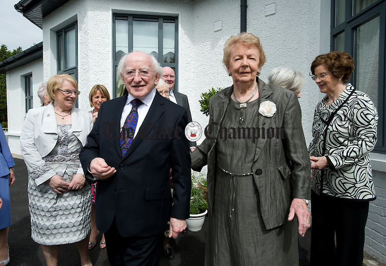 Lillian Sullivan, Director of the Alzheimers Society of Ireland with President Michael D Higgins on his arrival to the official opening of the Watermans Lodge day Care and Respite centre at Ballina. Photograph by John Kelly.