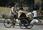 Pedicab driver take a customer home from shopping in Hanoi, North Vietnam.  (Jim Bryant Photo).....
