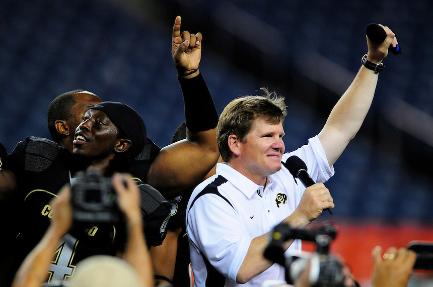 31 Aug 2008: Colorado coach Dan Hawkins and wide receiver Patrick Williams celebrate winning a game against Colorado State. The Colorado Buffaloes defeated the Colorado State Rams 38-17 at Invesco Field at Mile High in Denver, Colorado. FOR EDITORIAL USE ONLY