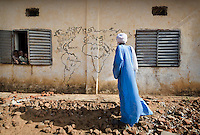 A map of the world painted on the wall of a school building in eastern Chad.