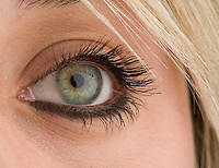 Close up of a blond woman with bright green eye.