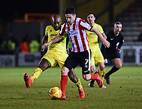 Lincoln City's Tom Pett vies for possession with Cheltenham Town's Nigel Atangana<br /> <br /> Photographer Andrew Vaughan/CameraSport<br /> <br /> The EFL Sky Bet League Two - Cambridge United v Lincoln City - Friday 9th February 2018 - Abbey Stadium - Cambridge<br /> <br /> World Copyright &copy; 2018 CameraSport. All rights reserved. 43 Linden Ave. Countesthorpe. Leicester. England. LE8 5PG - Tel: +44 (0) 116 277 4147 - admin@camerasport.com - www.camerasport.com