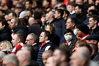 7th March 2020; Emirates Stadium, London, England; English Premier League Football, Arsenal versus West Ham United; Arsenal fans wear face masks during the match