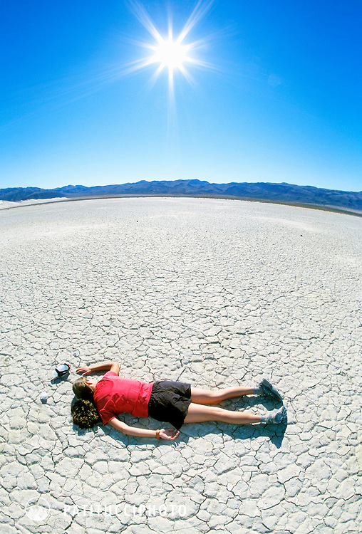 Dehydrated and exhausted runner caught out in the desert sun