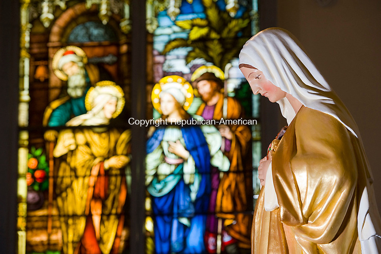 WATERBURY, CT-091517JS06-- The statue of the Virgin Mary and stained glass windows inside the Shrine of St. Anne Church in Waterbury. Jim Shannon Republican-American