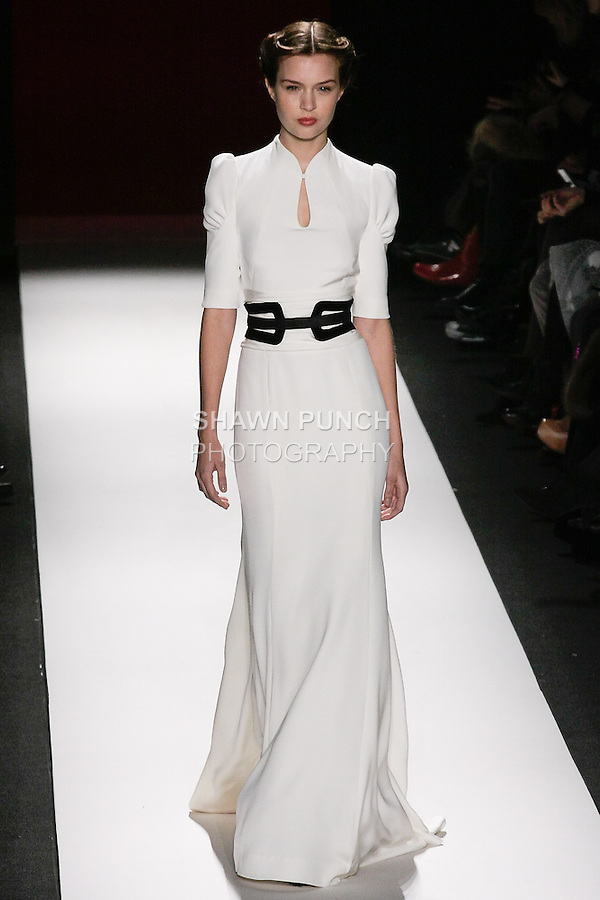 Model walks runway in an outfit from the Carolina Herrera Fall 2013 collection, during Mercedes-Benz Fashion Week Fall 2013.