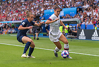 PARIS,  - JUNE 28: Marion Torrent #4 defends Alex Morgan #13 during a game between France and USWNT at Parc des Princes on June 28, 2019 in Paris, France.