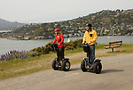 Couple on Segways, each on a Segway, on Angel Island State Park in San Francisco Bay, California, CA. Model released..Photo camari205-70398..Photo copyright Lee Foster, www.fostertravel.com, 510-549-2202, lee@fostertravel.com.