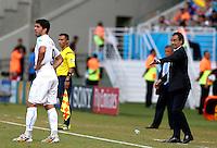 Italy coach Cesare Prandelli gestures toward Luis Suarez of Uruguay