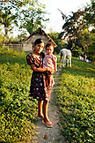 BELIZE, Punta Gorda, Toledo District, Nilsa Col holds her sister Wendy in front of their hom in the Maya village of San Jose