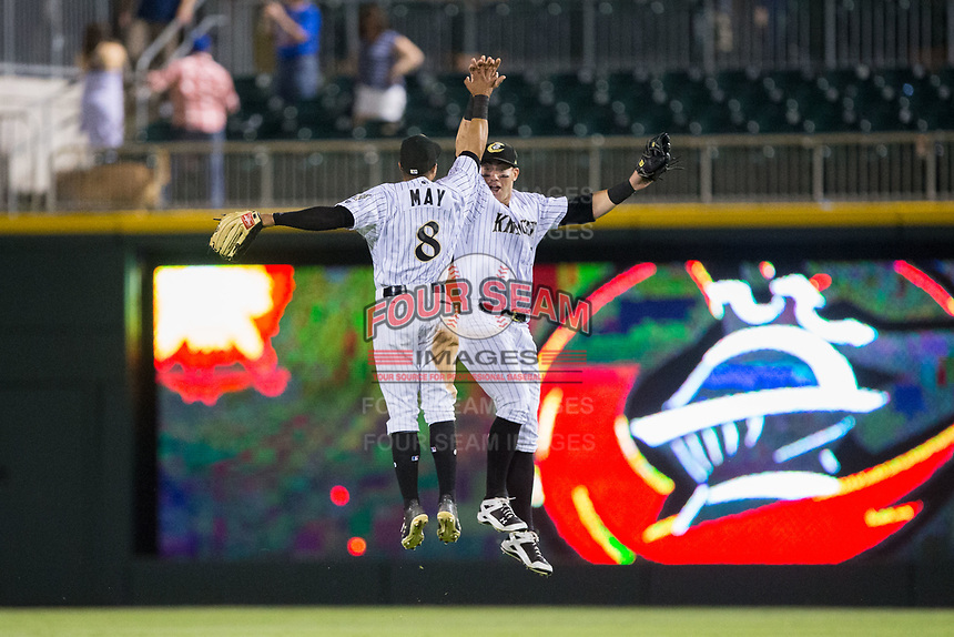 Charlotte Knights outfielders Jacob May (8) and Nicky Delmonico (13) celebrate their win over the Durham Bulls at BB&T BallPark on May 15, 2017 in Charlotte, North Carolina. The Knights defeated the Bulls 6-4.  (Brian Westerholt/Four Seam Images)