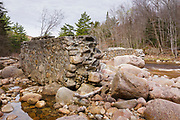 Stone abutments from the abandoned trestle No. 17 along the old East Branch & Lincoln Railroad (1893-1948) in the Pemigewasset Wilderness of Lincoln, New Hampshire. This trestle spanned the East Branch of the Pemigewasset River near logging Camp 17.