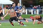 Leinster centre Ben Te'o looks for support as Quins full back Steff Evans closes in.<br /> British &amp; Irish Cup<br /> Carmarthen Quins v Leinster A<br /> Carmarthen Park<br /> 25.10.14<br /> &copy;Steve Pope-SPORTINGWALES